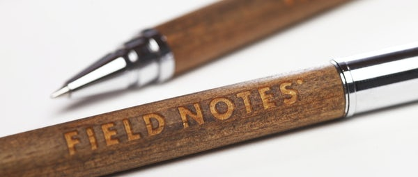 Close up of Field Notes name engraved in the wood of the Brand's Hall pen