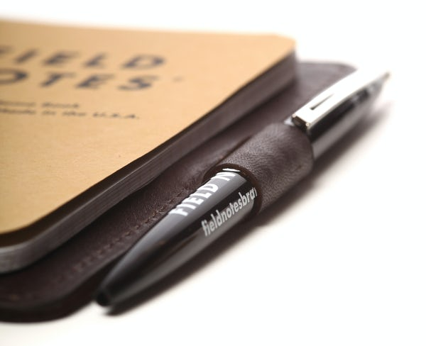 Close up of the pen loop with a notebook inside the Daily Carry leather notebook cover.