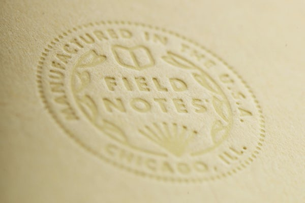 Close up of the debossed Field Notes seal on the Signature Series notebook.