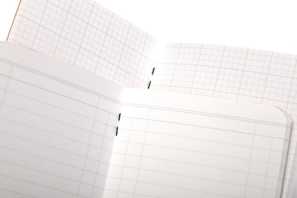 Close-ups of the inner pages of the Utility memo books, showing the ledger and engineer graph paper styles.
