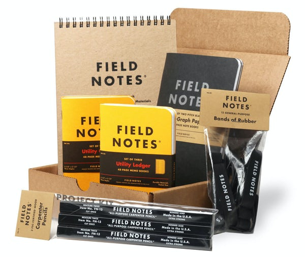 Field Notes Project Kit includes 1 brown Steno Pad, 1 larger sized Pitch Black 2-Pack, 2 Utility Ledger 3-Packs, 1 black Carpenter Pencil 3-Pack, and a 12-Pack of black rubber bands.