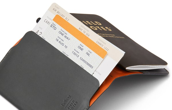 Everyday Inspiration leather cover open with a boarding pass and ticket sticking out of the pocket