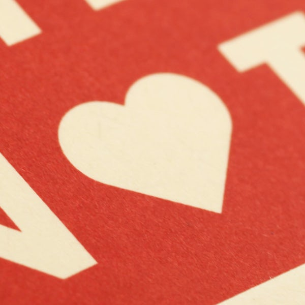 Close up of a brown heart on the red cover of the Heartbeat edition.