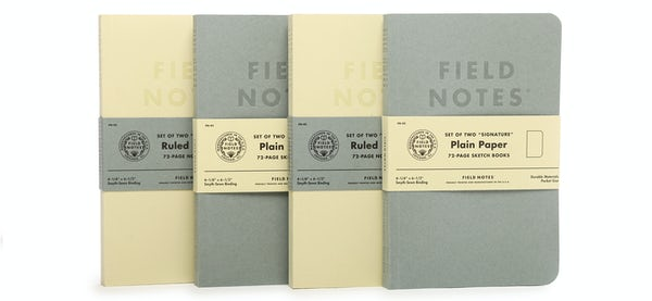 Row of 4 Signature Series cream color ruled paper 2-Packs and gray plain paper 2-Packs